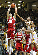 February 09 2011: Wisconsin Badgers forward Jon Leuer (30) grabs a rebound as Iowa Hawkeyes forward Jarryd Cole (50) reaches for the ball during the second half of an NCAA college basketball game at Carver-Hawkeye Arena in Iowa City, Iowa on February 9, 2011. Wisconsin defeated Iowa 62-59.