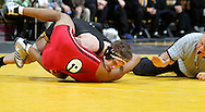 Iowa's Mark Ballweg pins Southern Illinois Edwardsville's Lawrence Blackful during the 141-pound bout of their dual at Carver-Hawkeye Arena, 1 Elliot Drive in Iowa City on Friday evening January 7, 2010. Ballweg pinned Blackful in 2:03 and Iowa defeated Southern Illinois Edwardsville 49-0.