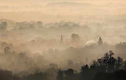 © Licensed to London News Pictures. 22/11/2018. Dorking, UK. Viewed from Box Hill the spire of Christ Church in Brockham rises above the early morning mist and frost. Photo credit: Peter Macdiarmid/LNP