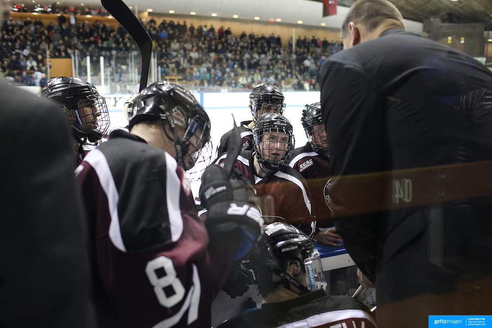 Rick Bennett, Union College head coach, talks to his players during a time out during the Yale Vs Union College, Men's College Ice Hockey game at Ingalls Rink, New Haven, Connecticut, USA. 28th February 2014. Photo Tim Clayton