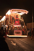 Way out West by Huckyduck Carnival Club. Portrait format, suitable for magazine cover. Bridgwater Carnival is an annual event to raise money for local charities. It is widely reputed to be the largest illuminated carnival in the world.