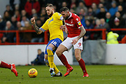 Leeds United defender Pontus Jansson (18)  and Nottingham Forest forward Daryl Murphy (9)  during the EFL Sky Bet Championship match between Nottingham Forest and Leeds United at the City Ground, Nottingham, England on 1 January 2019.
