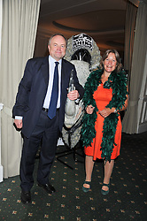 CATHY DEAN Director of Save The Rhino and CLIVE ANDERSON at a dinner in aid of the charity Save The Rhino held at ZSL London Zoo, Regents Park, London NW1 on 16th November 2011.