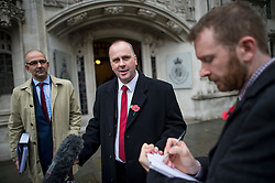 © London News Pictures. 04/11/2015. London, UK. Chip shop owner BARRY BEAVIS (centre) outside the Supreme Court in London after a judge at the UK's highest court ruled against him in a over parking charges case. Beavis, from Chelmsford, Essex, was challenging private parking operators who charged him £85 for overstaying his two hours of free parking. Photo credit: Ben Cawthra/LNP