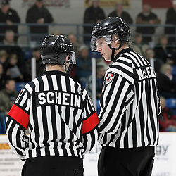 TRENTON, - Mar 5, 2016 -  Ontario Junior Hockey League game action between the Trenton Golden Hawks and the Newmarket Hurricanes. Game 3 of the first round playoff series at the Duncan Memorial Gardens, ON., OHA Referee Schein and OHA Linesman McLean during the second period<br /> (Photo by Amy Deroche / OJHL Images)