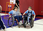 """Kellogg Foundation Assignment: Wheelchair Basketball..Kaycee Stebleton clashes wheelchairs with Conner Riffenhouse...The contact is Pam Patula, 888/957-6245 runs an organization.called Socil (S.E. center for Independent Living )a member of April.  A weekly wheelchair basketball game in Lancaster, held on Jan 20th. Saturday at 10am. The basketball coach, Brett Harbage, is an Independent Living Specialist from SOCIL.  Other coach is Cheryl """"Hutch"""" Hutchinson, she is the adaptive physical education instructor of Fairfield County.  The adaptive basketball games are part of the Upward Basketball league, .  This is only Upwards adaptive league in the nation."""