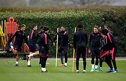 Arsenal's Pierre-Emerick Aubameyang (left) Laurent Koscielny (second from left) and Alexandre Lacazette (centre) during the training session at London Colney, Hertfordshire.