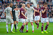 Andy Considine (#4) of Aberdeen FC argues with Steven Naismith (#14) of Heart of Midlothian during the Ladbrokes Scottish Premiership match between Heart of Midlothian and Aberdeen at Tynecastle Stadium, Edinburgh, Scotland on 20 October 2018.
