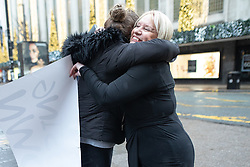 "© Licensed to London News Pictures . 01/12/2018. Manchester , UK . A staff member hugs General Manager ANNE LATHAM (r) upon receiving news that the store is saved . Staff take down "" Closing Down "" signs from the Kendal's House of Fraser department store on Deansgate in Manchester City Centre after a new rental agreement was secured with the landlord . Photo credit : Joel Goodman/LNP"
