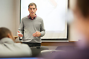 Ohio University Alumnus Andy Crago of Infoverity talks to students during the program A Day in the Life of an MIS Professional in The College of Business Thrusday April 3, 2014.  Photo by Ohio University / Jonathan Adams