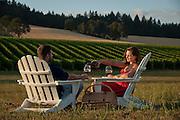 Couple enjoying wine tasting at Stoller Vineyards, Dundee Hills, Willamette Valley, Oregon.