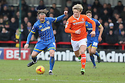 Dannie Bulman of AFC Wimbledon gets to the ball before Cameron McGeehan of Luton Town during the Sky Bet League 2 match between AFC Wimbledon and Luton Town at the Cherry Red Records Stadium, Kingston, England on 13 February 2016. Photo by Stuart Butcher.