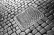 "Rone, Italy - Modern Manhole covers in Rome still bear the initals of the ancient Roman empire.  SPQR stood for the latin,  ""Sen?tus Populusque R?m?nus"" or ""The Senate and the People of Rome"""