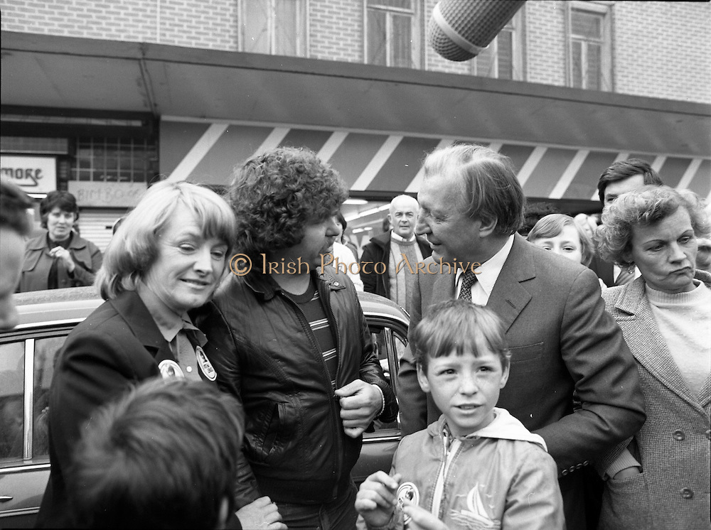 15/05/1982<br /> 05/15/1982<br /> 15 May 1982<br /> An Taoiseach, Mr Charles Haughey, canvasing with Fianna Fail bye-election candidate Eileen Lemass in Dublin West. Image shows An Taoiseach (right)  and Eileen Lemass (left) canvasing on Ballyfermot Road, possibly in front of Quinnsworth? .