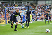 Everton striker Wayne Rooney (10) beats Brighton and Hove Albion midfielder Solomon (Solly) March (20) during the Premier League match between Brighton and Hove Albion and Everton at the American Express Community Stadium, Brighton and Hove, England on 15 October 2017. Photo by Phil Duncan.