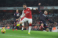 Football - 2017 / 2018 Premier League - Arsenal vs. Huddersfield Town<br /> <br /> Christopher Schindler of Huddersfield tries to block a shot from Olivier Giroud of Arsenal to the ball, at The Emirates.<br /> <br /> COLORSPORT/ANDREW COWIE