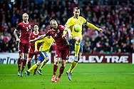 17.11.2015. Copenhagen, Denmark. <br /> Zlatan Ibrahimovic  (R) of Sweden fights for the ball with Lars Jacobsen  (L) of Denmark during their UEFA EURO 2016 play-off second leg round match at the Telia Parken Stadium. <br /> Photo: © Ricardo Ramirez.
