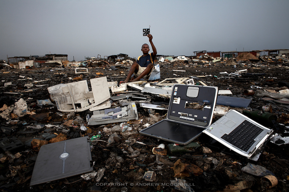 Discarded laptops lie on the ground at Agbogbloshie dump, in Accra, Ghana.
