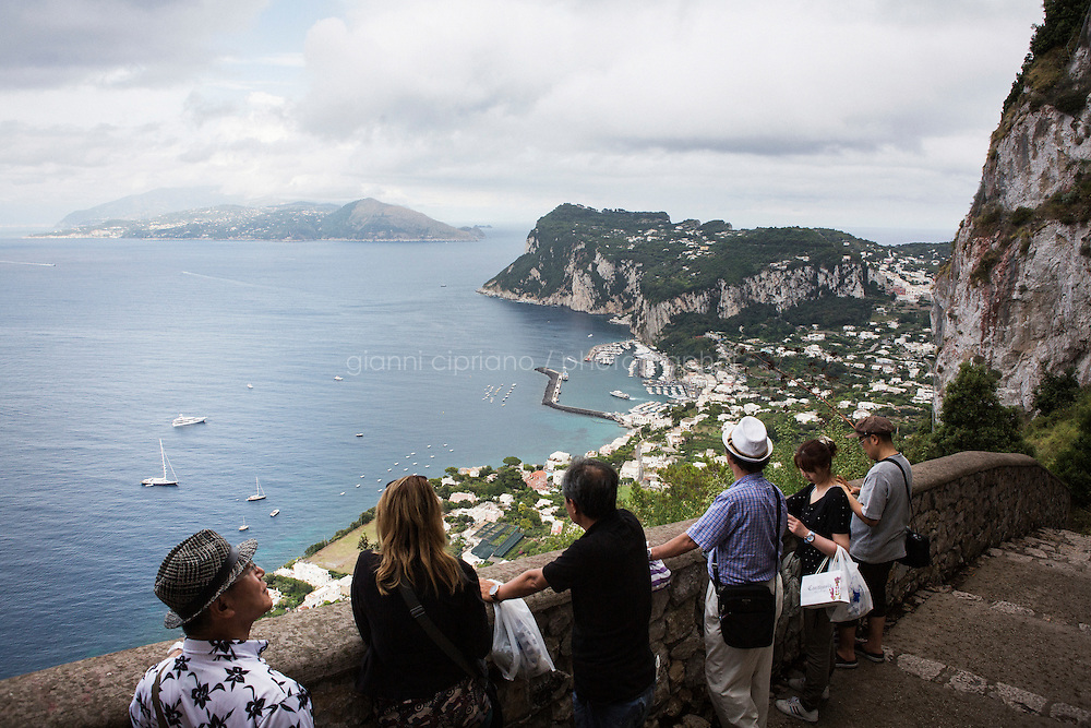 ANACAPRI, ITALY - 22 JULY 2014: Tourist enjoy a panoramic view of Capri and of Sorrento in mainland Italy (in the background) from Villa San Michele in Anacapri, a small comune on the island of Capri, Italy, on July 22nd 2014.<br /> <br /> New York City Mayor Bill de Blasio arrived in Italy with his family Sunday morning for an 8-day summer vacation that includes meetings with government officials and sightseeing in his ancestral homeland.