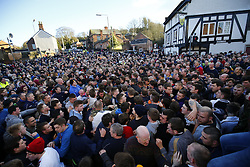 © Licensed to London News Pictures. 10/02/2016. Ashbourne, UK. Rival teams 'Up'ards' and 'Down'ards' battle for the ball during the second day of the Royal Shrovetide Football match in Ashbourne, Derbyshire on Wednesday, 10 February 2016. For two days, over Shrove Tuesday and Ash Wednesday, hundreds of participants battle it out in a 'no rules' game dating back to the 17th Century where the aim is to get a ball into one of two goals that are positioned three miles apart at either end of Ashboune. Photo credit: Tolga Akmen/LNP