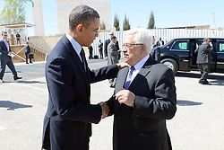 Palestinian President Mahmoud Abbas (R) shakes hands with U.S. President Barack Obama upon his arrival in the West Bank city of Ramallah on March 21, 2013. Obama arrived in Tel Aviv in Israel Wednesday to start his Mideast tour. Obama will spend three days in Israel, the Palestinian territories and Jordan, March 21, 2013. Photo by Imago / i-Images...UK ONLY.