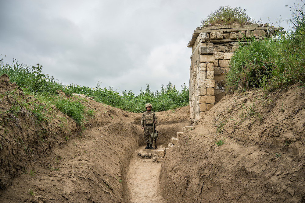 AGDAM, NAGORNO-KARABAKH - APRIL 21: A member of the armed forces of Nagorno-Karabakh at their post along the line of contact with Azerbaijani forces in the eastern direction on April 21, 2015 near the town of Agdam, Nagorno-Karabakh. Since signing a ceasefire in a war with Azerbaijan in 1994, Nagorno-Karabakh, officially part of Azerbaijan, has functioned as a self-declared independent republic and de facto part of Armenia, with hostilities along the line of contact between Nagorno-Karabakh and Azerbaijan occasionally flaring up and causing casualties. (Photo by Brendan Hoffman/Getty Images) *** Local Caption ***
