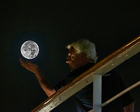 Viewing the Full Moon from the aft deck of the MV World Odyssey. Composite image taken with a Fuji X-T1 camera and 55-200 mm VR lens (ISO 6400, 200 mm, f/5.6, 1/60 sec)