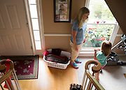 "Sally Isabella waits for her daughter, Brooke, to stop having a seizure on Thursday in Lawrenceville. Last year, Brooke was diagnosed with LGS, a severe form of epilepsy that causes her to have a large number of seizures per day. Many of these seizures or ""butterflies"" as the family calls them, are absent, which means Brooke loses the ability to comprehend what is going on around her for a short period of time. ""Are you back?"" is a common saying in the Isabella home. (Staff Photo: David Welker)"