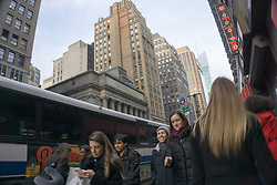 people walking on the street in New York City