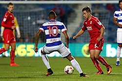 Jordan Stewart of Swindon Town runs with the ball and takes on Tjarron Chery of Queens Park Rangers - Mandatory by-line: Robbie Stephenson/JMP - 10/08/2016 - FOOTBALL - Loftus Road - London, England - Queens Park Rangers v Swindon Town - EFL League Cup