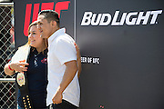 HOUSTON, TX - OCTOBER 3:  Erik Perez poses for a photo with a fan during the UFC 192 fan village at the Toyota Center on October 3, 2015 in Houston, Texas. (Photo by Cooper Neill/Zuffa LLC/Zuffa LLC via Getty Images) *** Local Caption *** Erik Perez