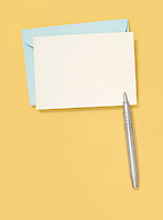 blank greeting card and pen