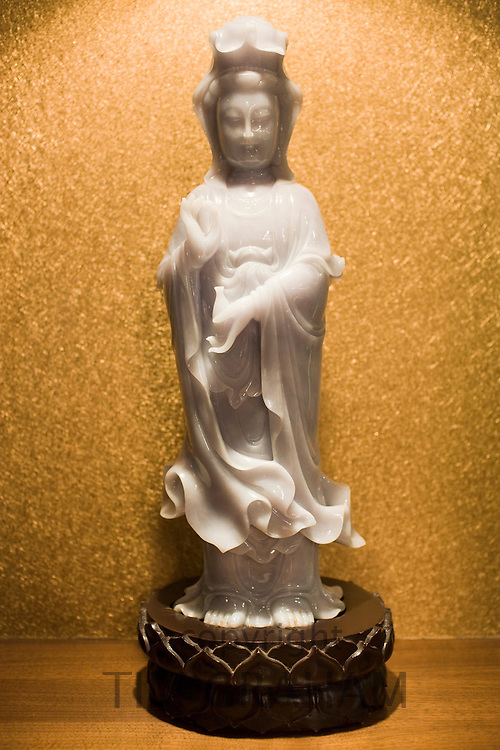 Lavender jade Goddess of Mercy figurine on display in the Huahui Jade Factory and Showroom, Xian, China