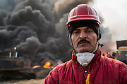 Joseph Abdullah Juad, a firefighter from Kirkuk, explains how they are fighting the flames by pumping large volumes of water into the heart of the fires.