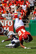 Fullback Mike Cox #42 of the Kansas City Chiefs gets upended by defensive back Dre Bly #32 of the Denver Broncos in the second quarter at Arrowhead Stadium in Kansas City, Missouri on September 28, 2008....