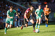 Dylan Connolly of Bradford City is chased by Jack Iredale of Carlisle United during the EFL Sky Bet League 2 match between Bradford City and Carlisle United at the Utilita Energy Stadium, Bradford, England on 21 September 2019.