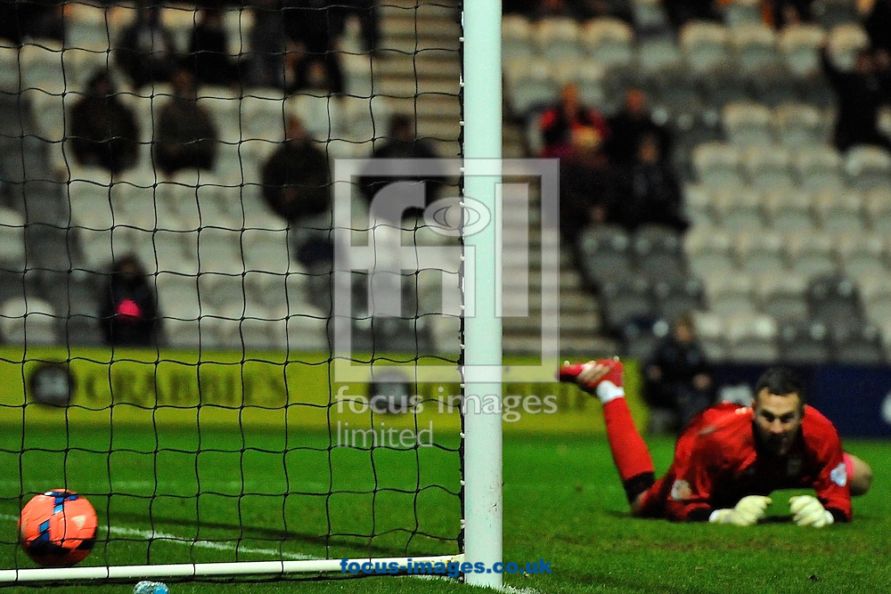 Picture by Ian Wadkins/Focus Images Ltd +44 7877 568959<br /> 14/01/2014<br /> Scott Loach of looks on as the shot from Joe Garner of Preston North End goes in to make it Preston North End 3 Ipswich Town 2 during the The FA Cup match at Deepdale, Preston.