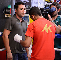 Dec 11,2012.  Montebello CA. USA. Oscar De La Hoya(L) watches Amir Khan works out for the press during a media day Tuesday afternoon at the Ponce De Leon Boxing Club.  Amir Khan will be fighting Carlos Molina this Saturday night at the Los Angeles Sports Arena live on ShowTime. .Photo By Gene Blevins/LA Daily News
