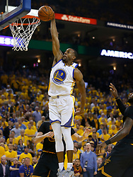 The Golden State Warriors' Andre Iguodala (9) dunks against the Cleveland Cavaliers in the second quarter of Game 5 of the NBA Finals at Oracle Arena in Oakland, Calif., on Monday, June 12, 2017. (Photo by Nhat V. Meyer/Bay Area News Group/TNS) *** Please Use Credit from Credit Field ***