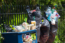Bags of rubbish still await collection on the day following the wedding of Prince Harry to Meghan Markle in Windsor, Berkshire. WINDSOR, May 20 2018.