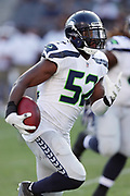 Seattle Seahawks linebacker Terence Garvin (52) runs for a first quarter touchdown that gives the Seahawks a 10-7 lead after recovering a fumble during the 2017 NFL week 1 preseason football game against the against the Los Angeles Chargers, Sunday, Aug. 13, 2017 in Carson, Calif. The Seahawks won the game 48-17. (©Paul Anthony Spinelli)