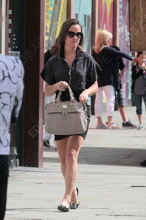 14.JULY.2011. LONDON<br /> <br /> PIPPA MIDDLETON GRABS A COFFEE IN LONDON.<br /> <br /> BYLINE: EDBIMAGEARCHIVE.COM<br /> <br /> *THIS IMAGE IS STRICTLY FOR UK NEWSPAPERS AND MAGAZINES ONLY*<br /> *FOR WORLD WIDE SALES AND WEB USE PLEASE CONTACT EDBIMAGEARCHIVE - 0208 954 5968*