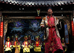 Performers of the Naxi ethnic minority perform traditional folk music in a culture show, the Naxi Impression Show in Lijiang, Yunnan Province, China, 04 April 2012. The Naxi ethnic minority  group is one of the main ethnic minority groups settled in Lijiang, Yunnan province with a unique culture and traditions. The religious Dongba scriptures of the Naxi has been recognised as World Memory Heritage by UNESCO in 2003.