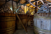 Photo shows the the giant barrels of Hatcho miso, some of them more than 100 years old, at Maruya Hatcho Miso Co. in Okazaki City, Aichi Prefecture Japan on 11 Dec. 2012. Hatcho miso has been made continuously by the company since 1337. Photographer: Robert Gilhooly