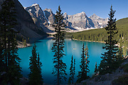 "A yellow canoe plies blue-green Moraine Lake in Valley of the Ten Peaks, Banff National Park, Alberta, Canada. Banff is part of the Canadian Rocky Mountain Parks World Heritage Site declared by UNESCO in 1984. Panorama stitched from 5 images. Published in ""Light Travel: Photography on the Go"" book by Tom Dempsey 2009, 2010."