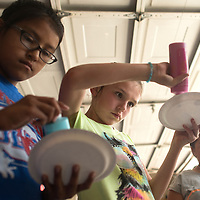 From left, Violet Daychief, Alex DeArmond and Karley Saucedo get paint for their monster project during the first Kids Crazy Creations class in Gallup Friday. The class is run by Kelly Stapp, an art teacher for Juan de Onate Elementary School and will run through the summer.