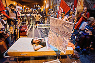 """Roma 4 Settembre  2015<br /> Manifestazione dei movimenti per il diritto all'abitare al quartiere San Lorenzo,contro gli sgomberi delle case occupate e gli sfratti. I manifestanti hanno messo dei mobili per la strada per «protestare contro il caro affitti per gli studenti».<br /> Rome, 4 September 2015<br /> Demonstration of the movements for housing rights, in the San Lorenzo district, against evictions of occupied houses and evictions. Protesters put the furniture in the street to """"protest against higher rents for students."""""""