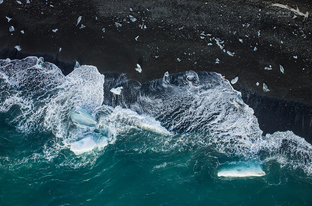Newly-washed up icebergs at Jokulsarlon Glacier Lagoon (Jökulsárlón) near Vatnajokull, Iceland. The glacier calves into a lagoon, and at each outgoing tide, icebergs flow out into the ocean and are pushed onto the black-sand beach by waves. #aerial @DJIGlobal #Phantom #Ricoh