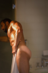 nude man at home in the bathroom after a shower