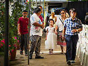 18 SEPTEMBER 2016 - BANGKOK, THAILAND: A family walks into Santa Cruz Church before the church's 100th anniversary mass. Santa Cruz Church was establised in 1769 to serve Portuguese soldiers in the employ of King Taksin, who reestablished the Siamese (Thai) empire after the Burmese sacked the ancient Siamese capital of Ayutthaya. The church was one of the first Catholic churches in Bangkok and is one of the most historic Catholic churches in Thailand. The first sanctuary was a simple wood and thatch structure and burned down in the 1800s. The church is in its third sanctuary and was designed in a Renaissance / Neo-Classical style. It was consecrated in September, 1916. The church, located on the Chao Phraya River, serves as a landmark for central Bangkok.       PHOTO BY JACK KURTZ